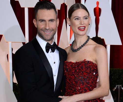 Adam Levine and Behati Prinsloo share first photo of newborn daughter