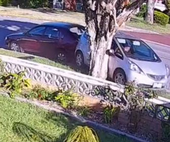 Security camera records alleged drunk driver's bizarre reverse crash
