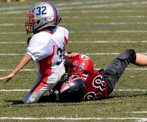 Ex-NFL greats: No tackle football before kids turn 14