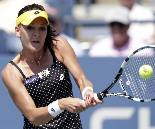 Radwanska rolls into quarters on home soil