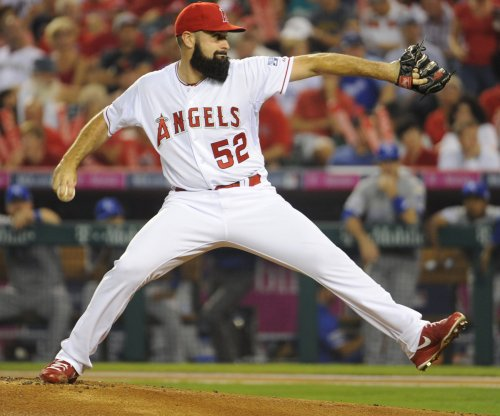 Los Angeles Angels P Matt Shoemaker using protective headwear