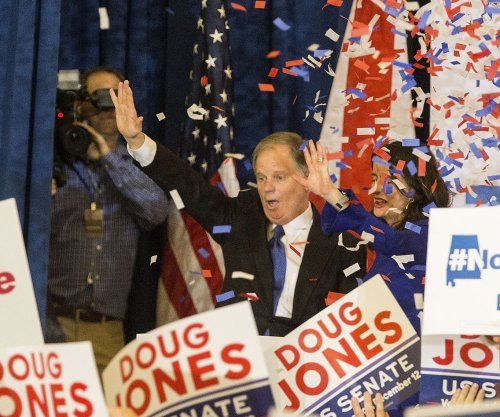 Doug Jones defeats Roy Moore in tight Alabama Senate race