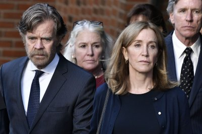 Felicity Huffman reports to prison for 14-day sentence