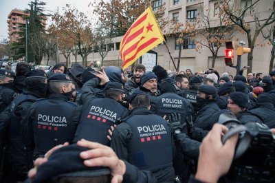 Police, protesters clash over seizure of artwork in Catalonia
