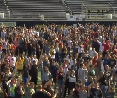 2,344 drink cans opened simultaneously for Guinness record