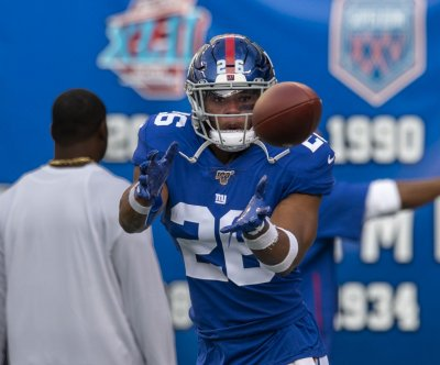 New York Giants RB Saquon Barkley exits with ankle injury