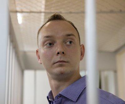 Russia opens treason probe into space agency adviser, former journalist