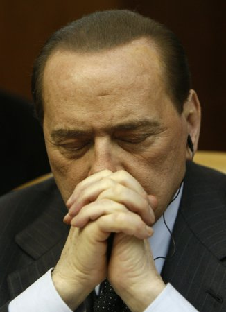 Report: Berlusconi, wife reach settlement