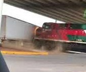 Train collides with semi truck stuck across the tracks