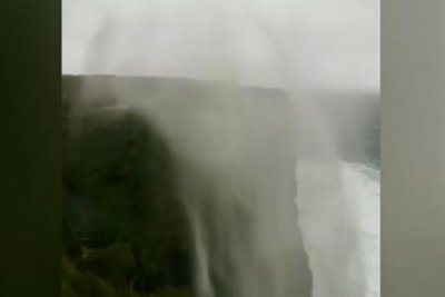 High winds cause waterfall to flow backward