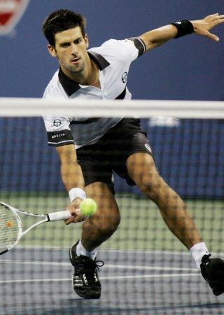 Djokovic needs third set to win Dubai