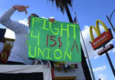 Michigan Gov. Rick Snyder raises minimum wage to $9.25