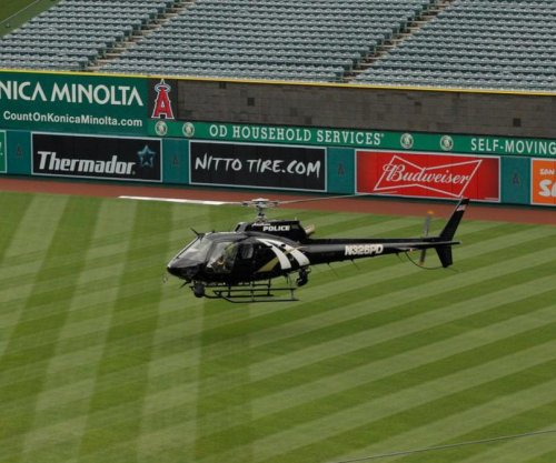 Video: Los Angeles Angels use chopper to dry field