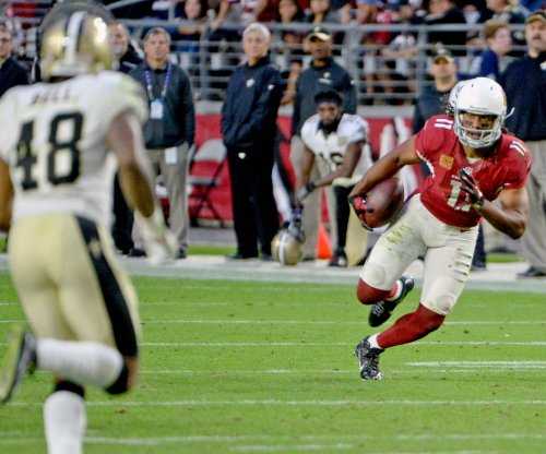 Arizona Cardinals coach Bruce Arians wants Larry Fitzgerald back