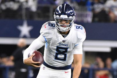 Titans QB Mariota limited, listed as questionable