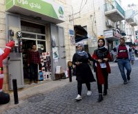 Biblical city of Bethlehem quiet as Christmas season begins without tourists