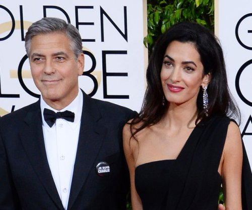 Amal Clooney sports casual look to visit George Clooney on set