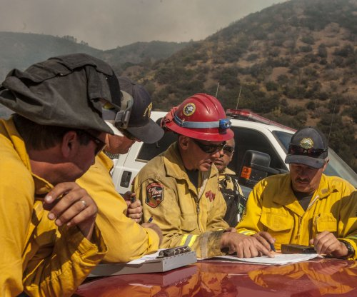 Four firefighters injured as California battles two growing fires