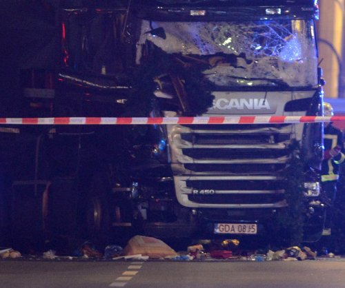 At least 12 killed, 48 hurt by truck at Berlin holiday market; possible suspect arrested