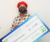 Burned-out Christmas tree lights lead woman to $171,000 lottery jackpot