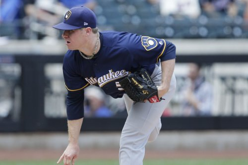 MLB: Milwaukee Brewers pitcher Chase Anderson leaves after first inning