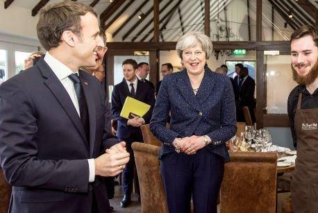 Britain's May, France's Macron shore up defense commitment