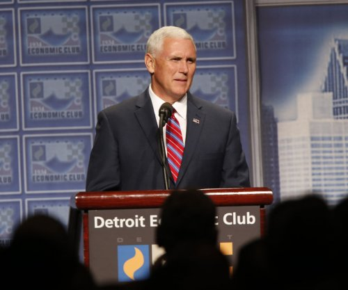 Mike Pence hedges on support for free trade deals