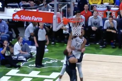 Giannis Antetokounmpo dunks all over Blake Griffin