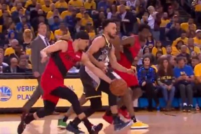 Portland Trail Blazers' Seth Curry steals ball from Warriors' Stephen Curry