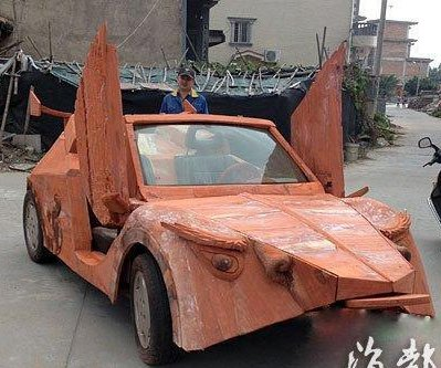 Mock Lamborghini carved from mahogany