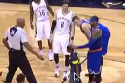 Boy hugs New York Knicks' Carmelo Anthony during game