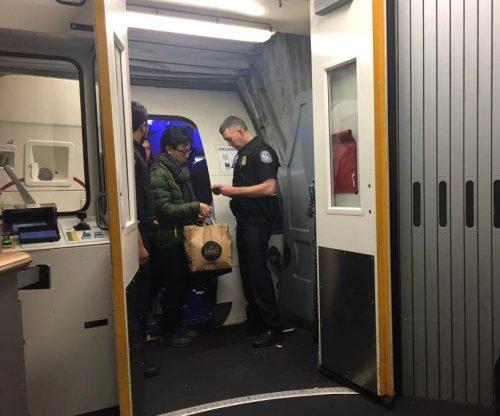 Border patrol agents check IDs of domestic flight passengers in New York