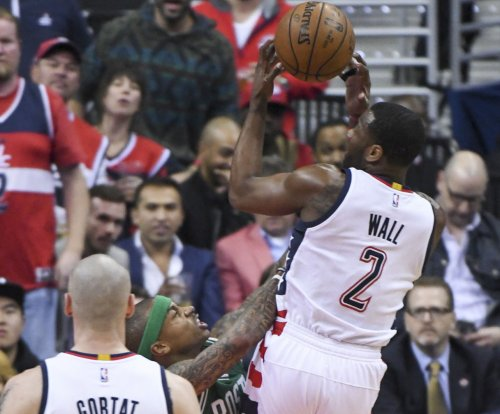 John Wall hits clutch three to give Washington Wizards win, force Game 7