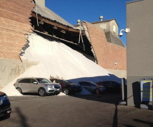 Morton factory wall collapses, dumping salt on car dealership lot
