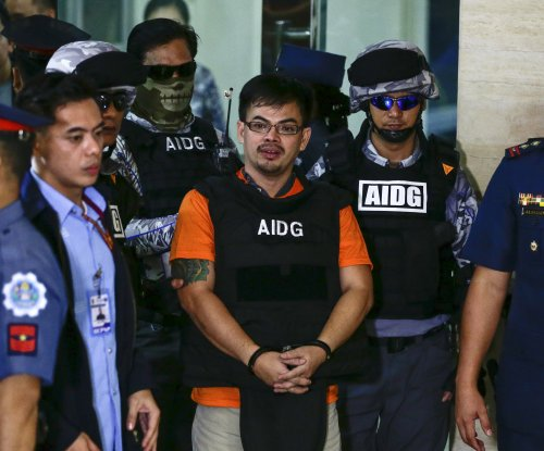 Accused drug lord, son of slain mayor, arrives in Philippines
