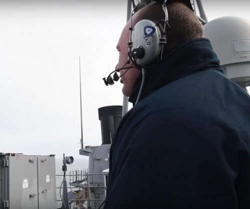 Guided-missile destroyer USS Hue City conducts live-fire exercise