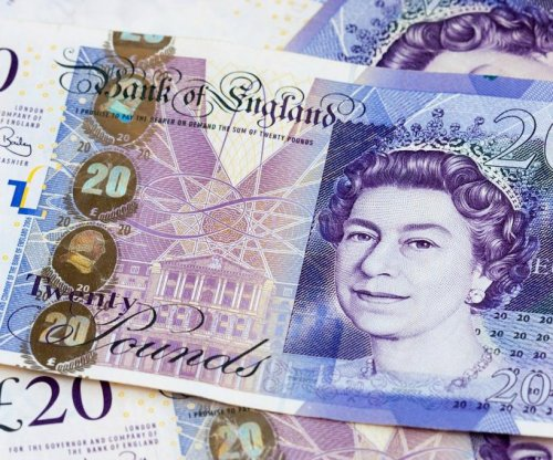 Woman charged with theft for pocketing stray banknote