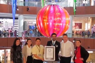 Dubai mall installs world's largest Christmas bauble