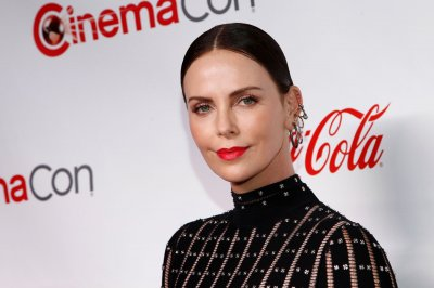 Charlize Theron denies feud with Angelina Jolie: She's 'always so lovely'