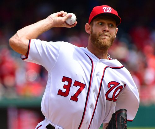 Washington Nationals back Stephen Strasburg with 20 hits in 13-3 win over Oakland A's