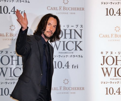 Keanu Reeves is back in a phone booth in new 'Bill & Ted' photo