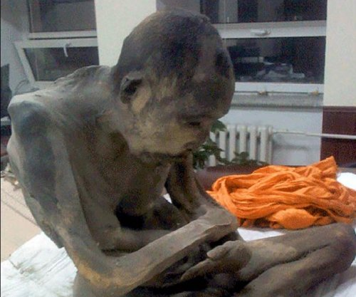 200-year-old mummified monk 'not dead, almost a Buddha'