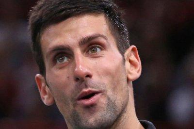 Djokovic, Wawrinka, Nishikori reach Aussie QFs