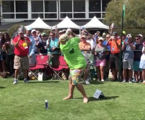 John Daly tees ball off beer can, drinks beer