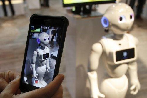 Japan's SoftBank launches new AI vacuum robot amid 'labor shortage'