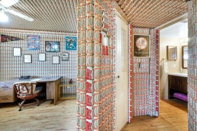 Florida-condo-for-sale-has-Budweiser-cans-covering-walls,-ceilings