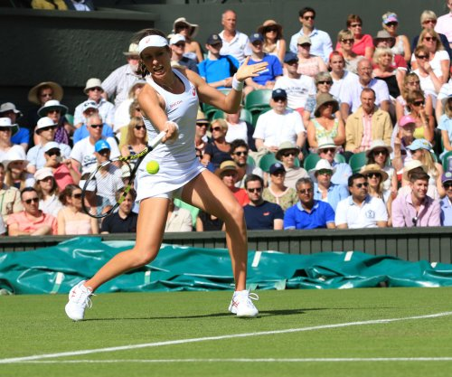 Johanna Konta tops Venus Williams for first singles title