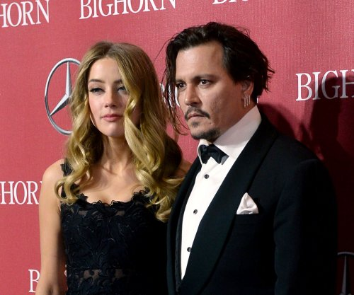Amber Heard accuses Johnny Depp of domestic violence, seeks restraining order
