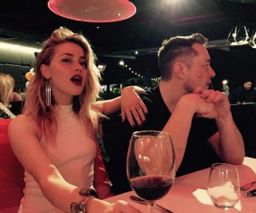 Amber Heard, Elon Musk get 'cheeky' during first public outing
