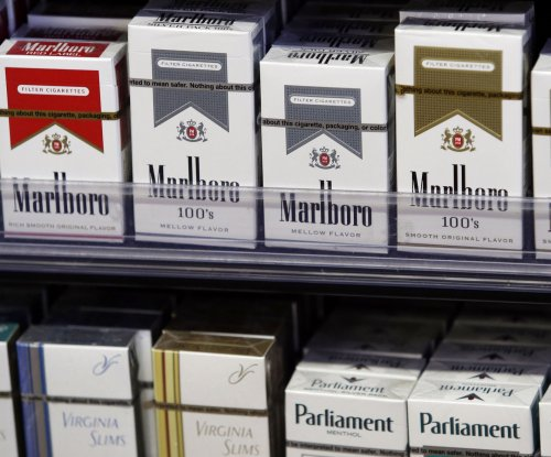 On This Day: Tobacco companies settle flight attendant suit